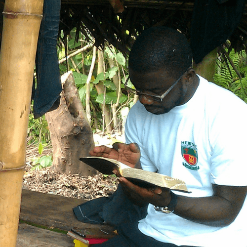 Student studying the Bible in a village on Project Timothy excursion
